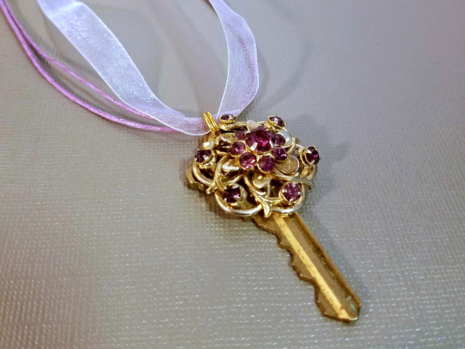upcycled repurposed key necklace with vintage purple rhinestonefiligree