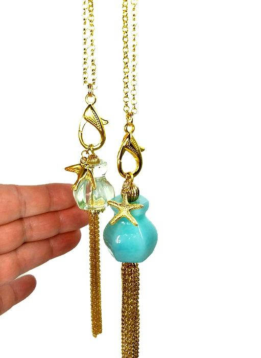 ocean inspired gold tassel necklaces