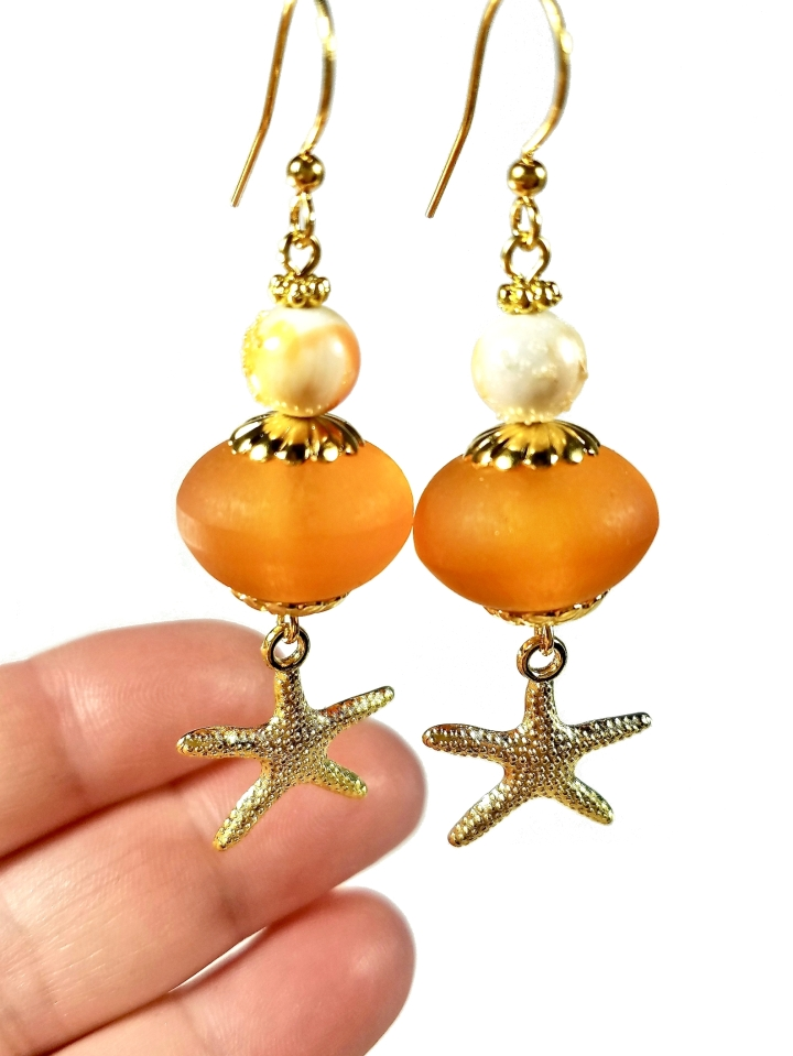 orange starfish dangle earrings