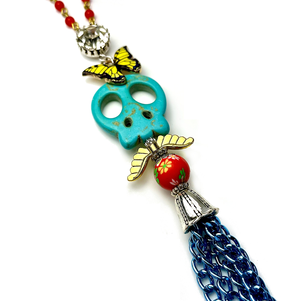 Long skull butterfly necklace